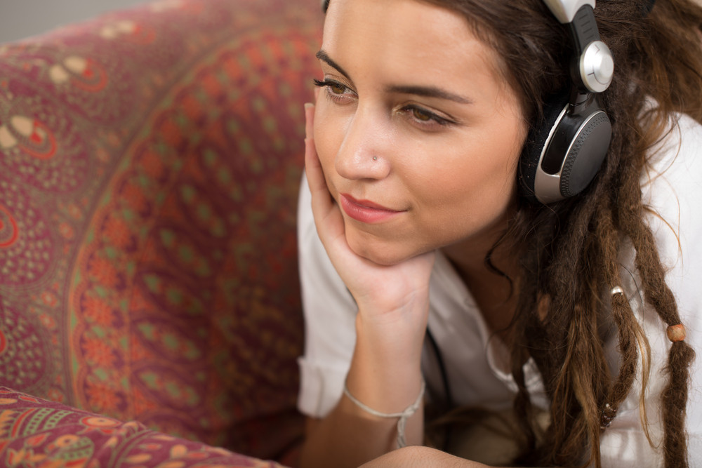 Portrait of pensive girl listening to the music