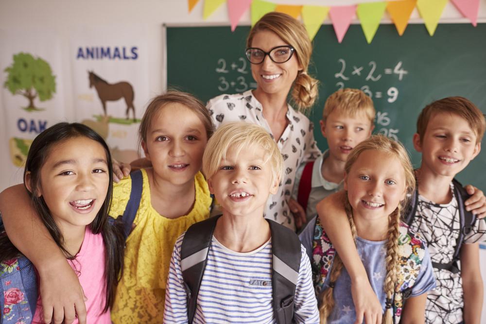 Portrait of school children with teacher