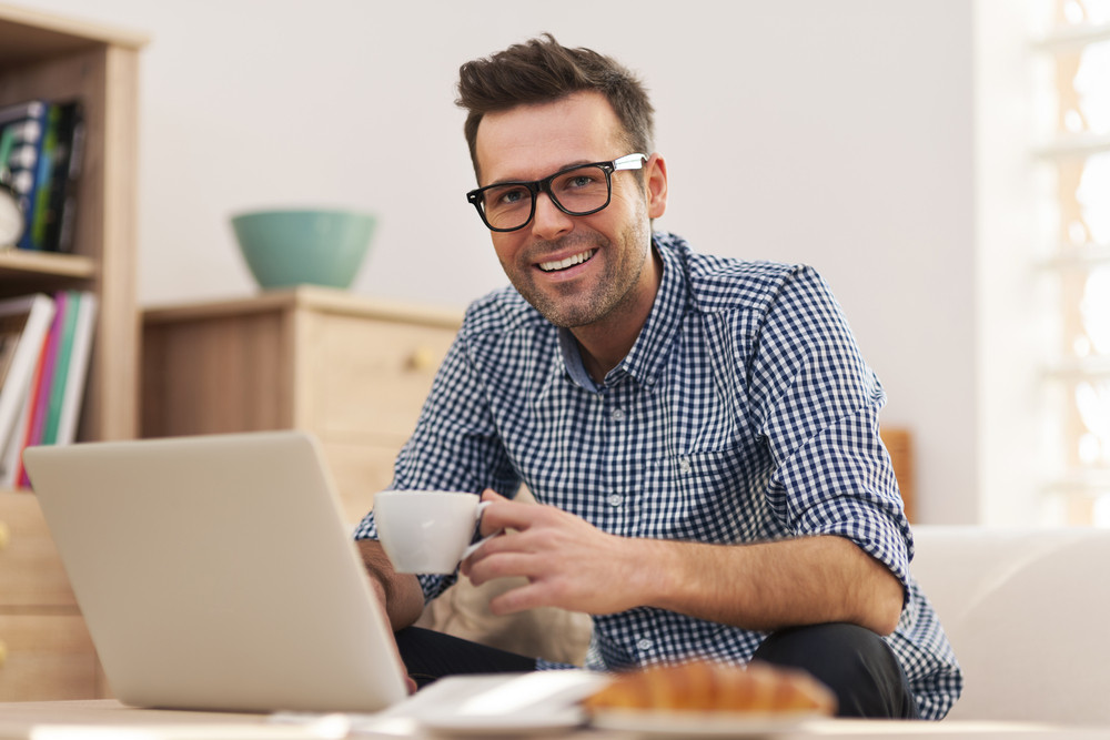 Portrait of smiling man working at home