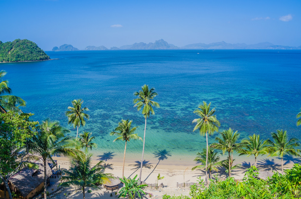 Sandy Beach with Palm Shadows, Huge Rocks in Background, El Nido, Palawan, Philippines