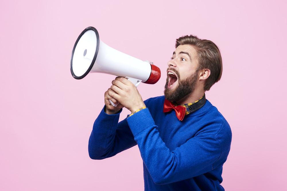 Screaming man using a megaphone