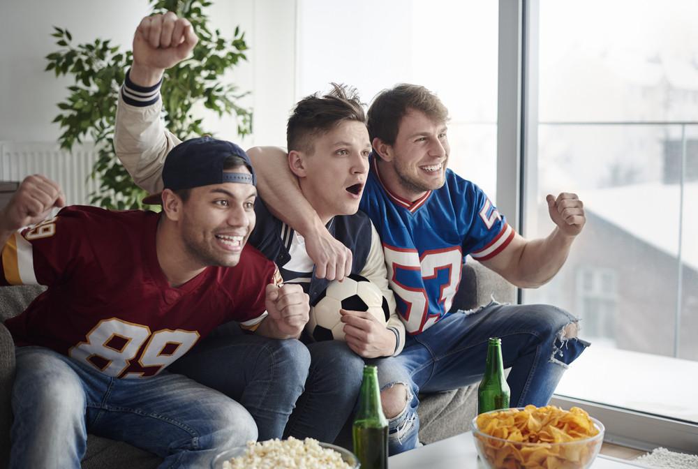 Shot of hardcore soccer fans celebrating