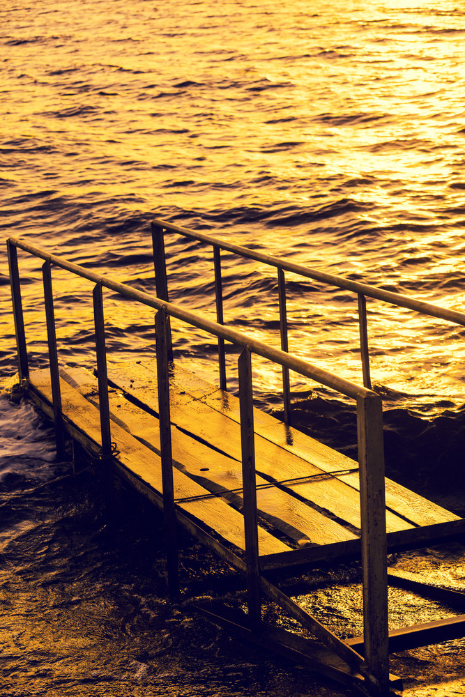 Small pier in the sea at sunset
