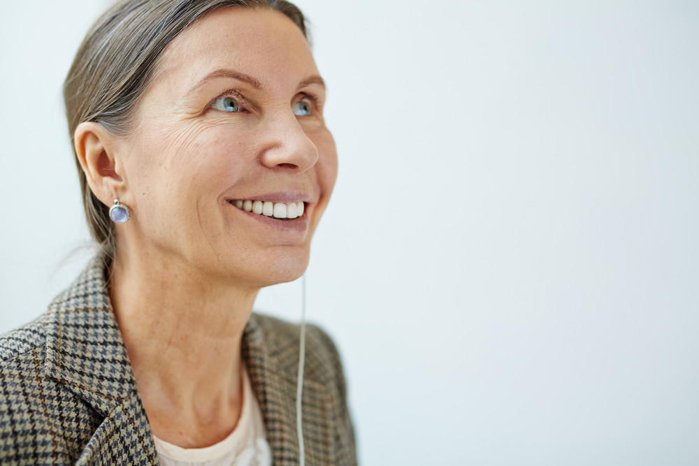 Smiling teacher with earphone during break
