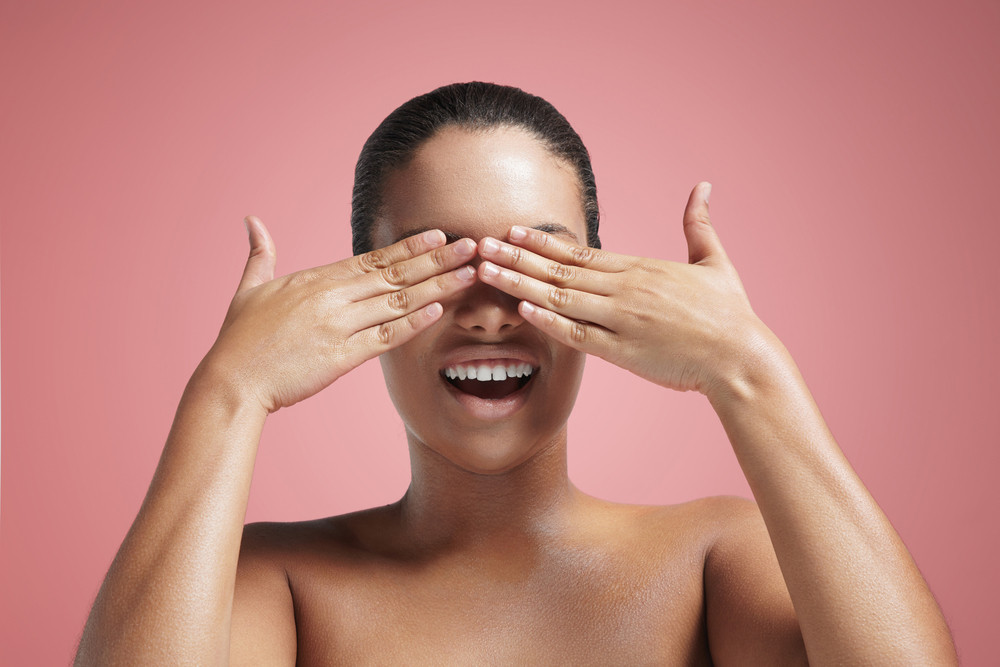 smiling woman closed eyes with a hand