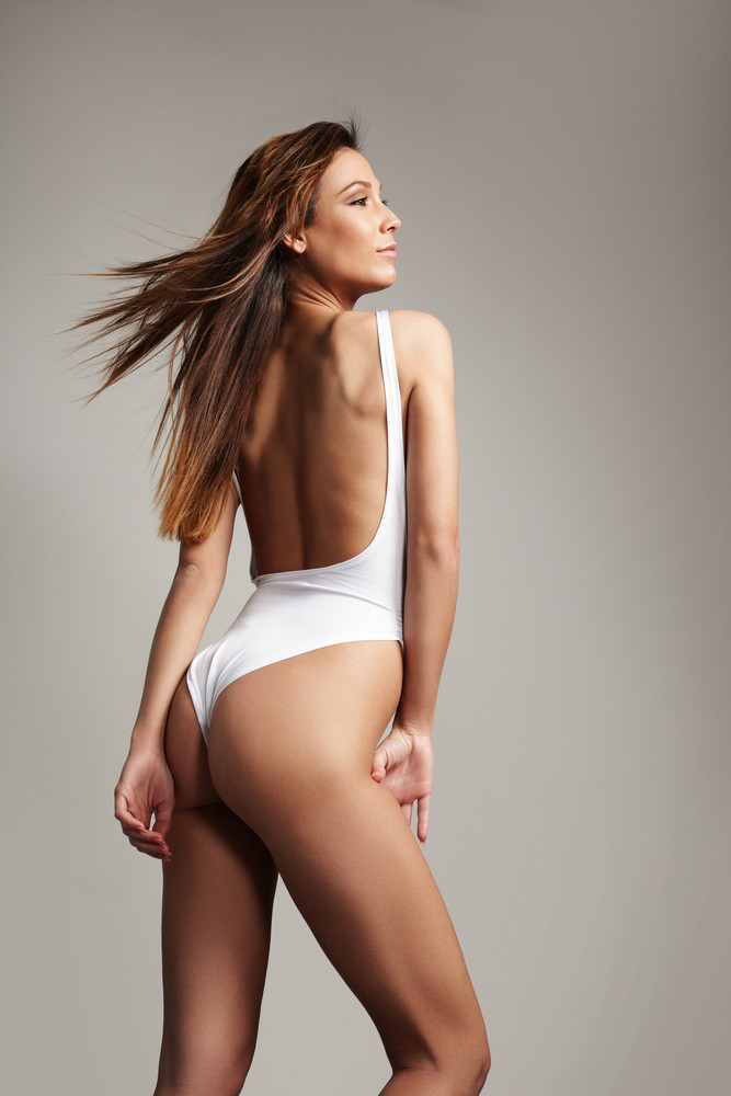 spanish beauty woman from the back with flying hair