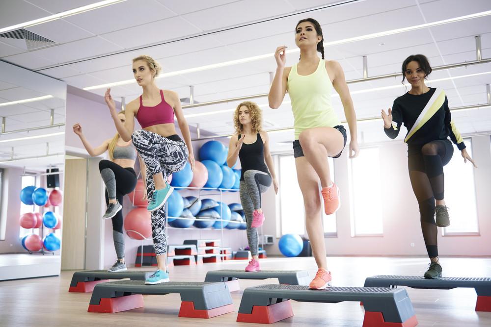 team of women having step aerobics class royalty free stock image