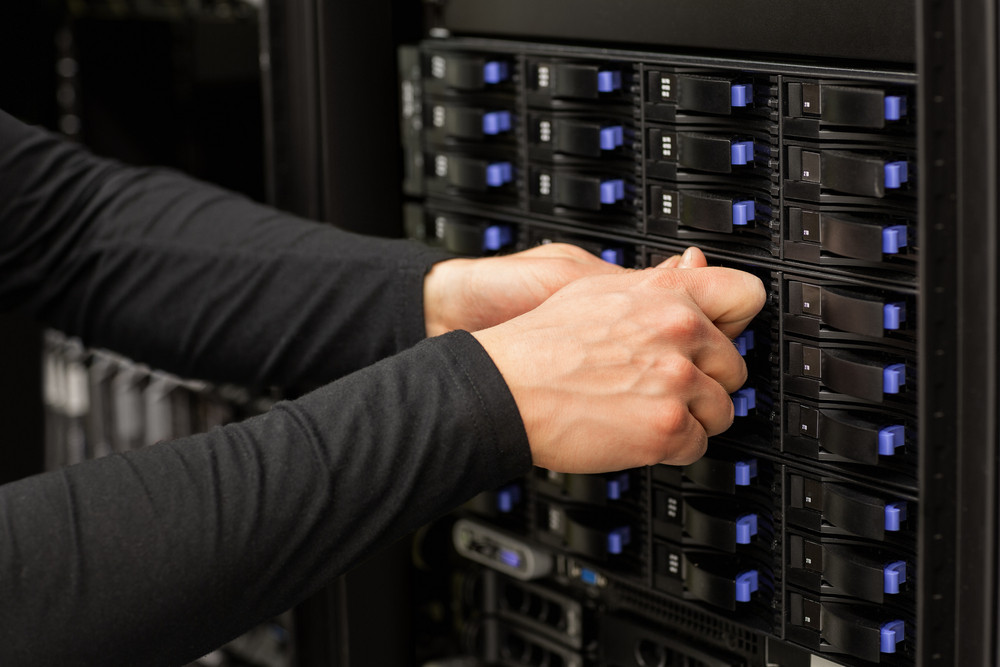 Technical Consultant Adjusting Hard Drives Stack In SAN At Datac