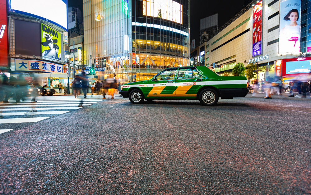 TOKYO, JAPAN - SEPTEMBER 25, 2017: Traffic crosses the Shibuya Scramble crosswalk, one of the busiest intersections in the world.