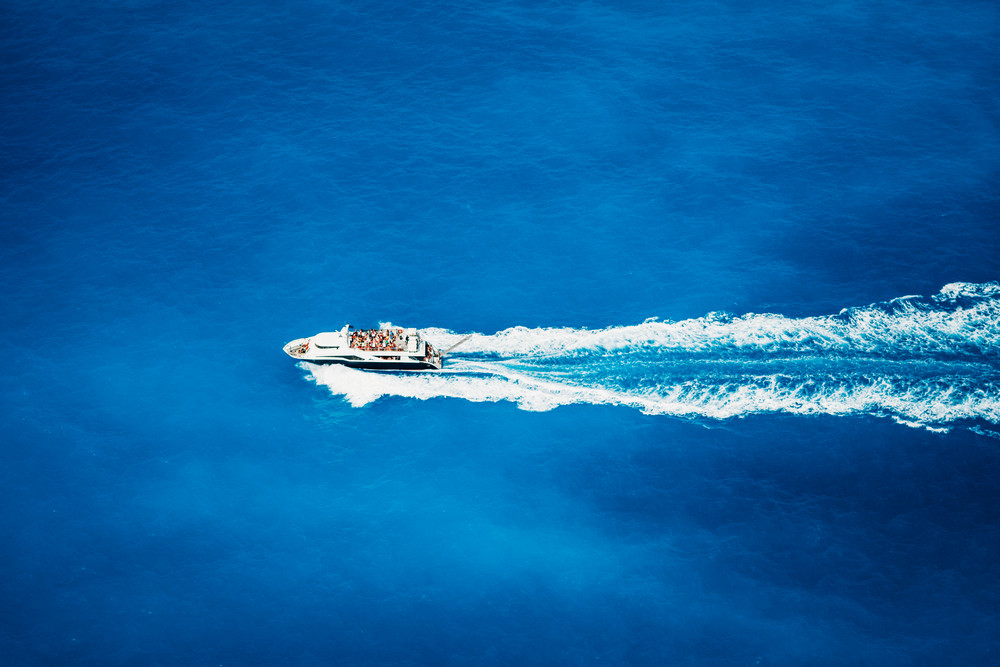 Top view of tourist boat sailing in the sea on full speed