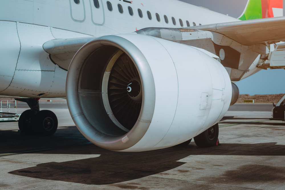 Turbine of passenger jet that waiting for departure in airport in warm afternoon light