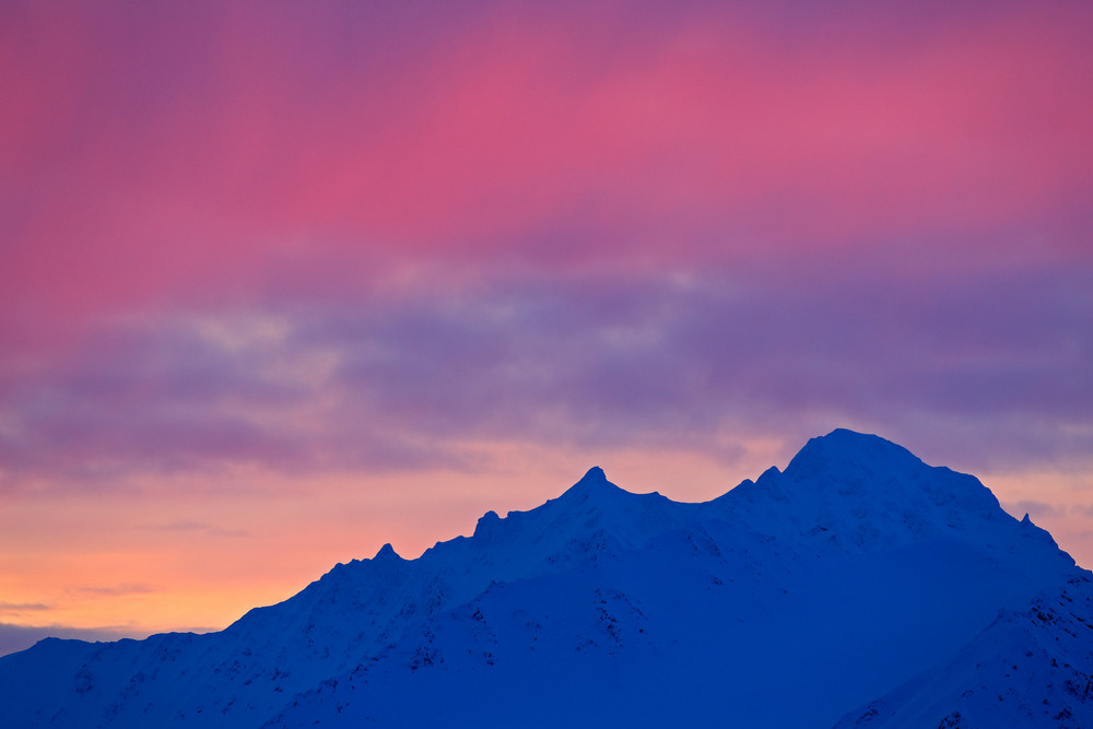 Winter Arctic. White snowy mountain, blue glacier Svalbard, Norway. Ice in ocean. Iceberg twilight in North pole. Pink clouds with ice floe. Beautiful landscape. Land of ice. Night ocean with ice.