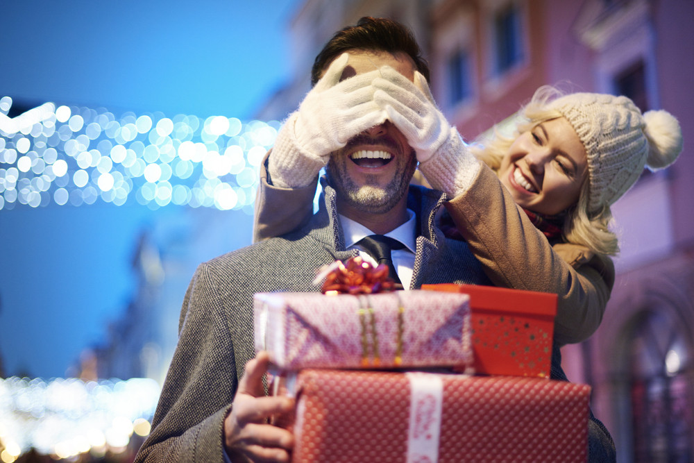 Woman covering her partners eyes