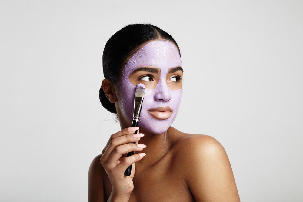 woman has fun with a facial mask