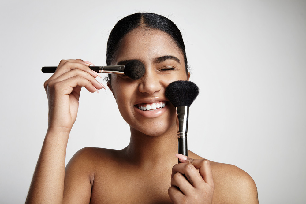 woman have fun with a cosmetic brushes
