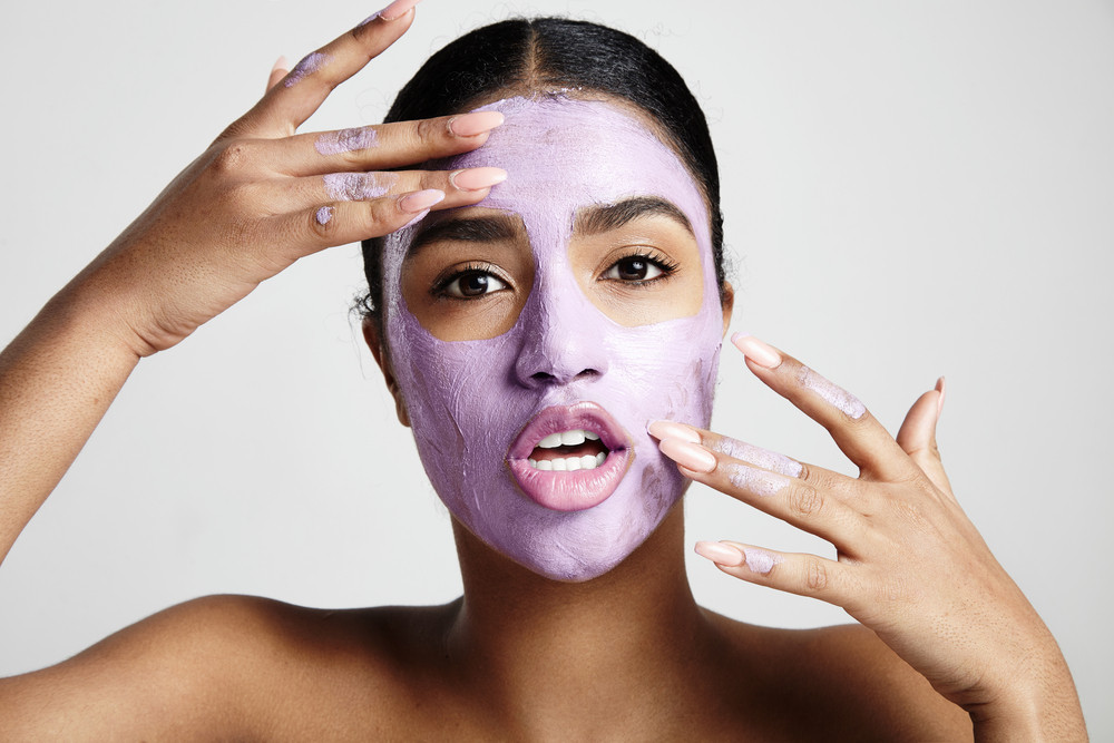 woman have fun with a facial mask