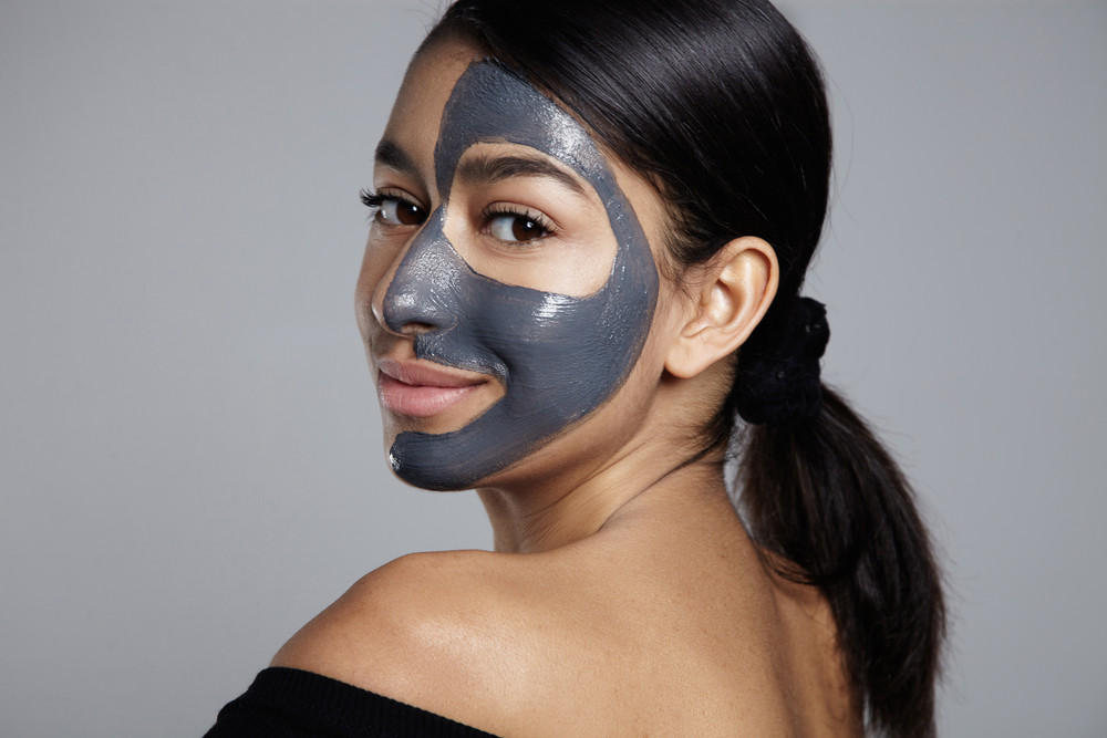 woman turned back to camera with facial mask on
