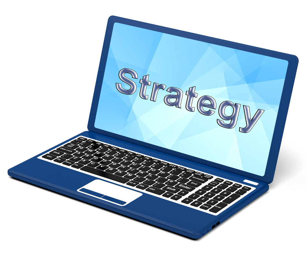 Strategy Word On Laptop Showing Teamwork And Planning