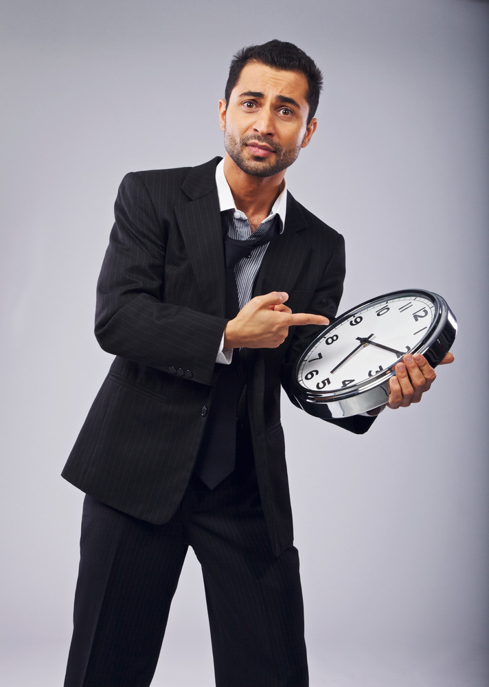 Stressed businessman with a clock