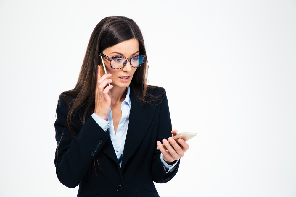 Stressed businesswoman talking on the phone