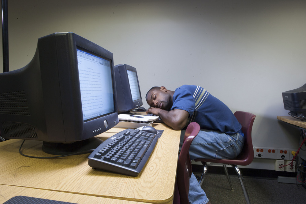 Student sleeping in computer lab