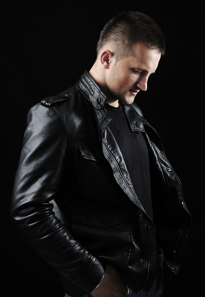 Stylish Fashion Young Man Portrait With Leather Jacket On Black