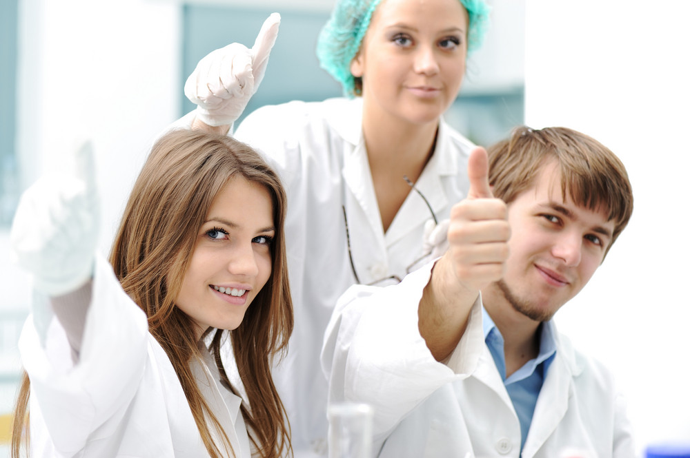 Successful teamwork inside the lab, research, young experts, thumbs up