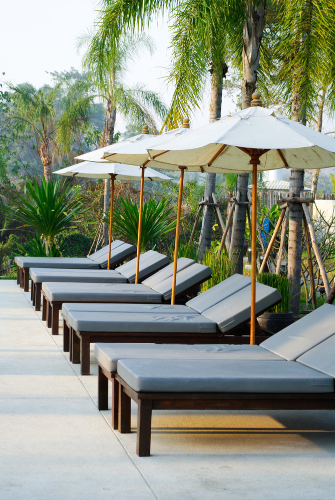 Sunbed beside swimming pool , Thailand