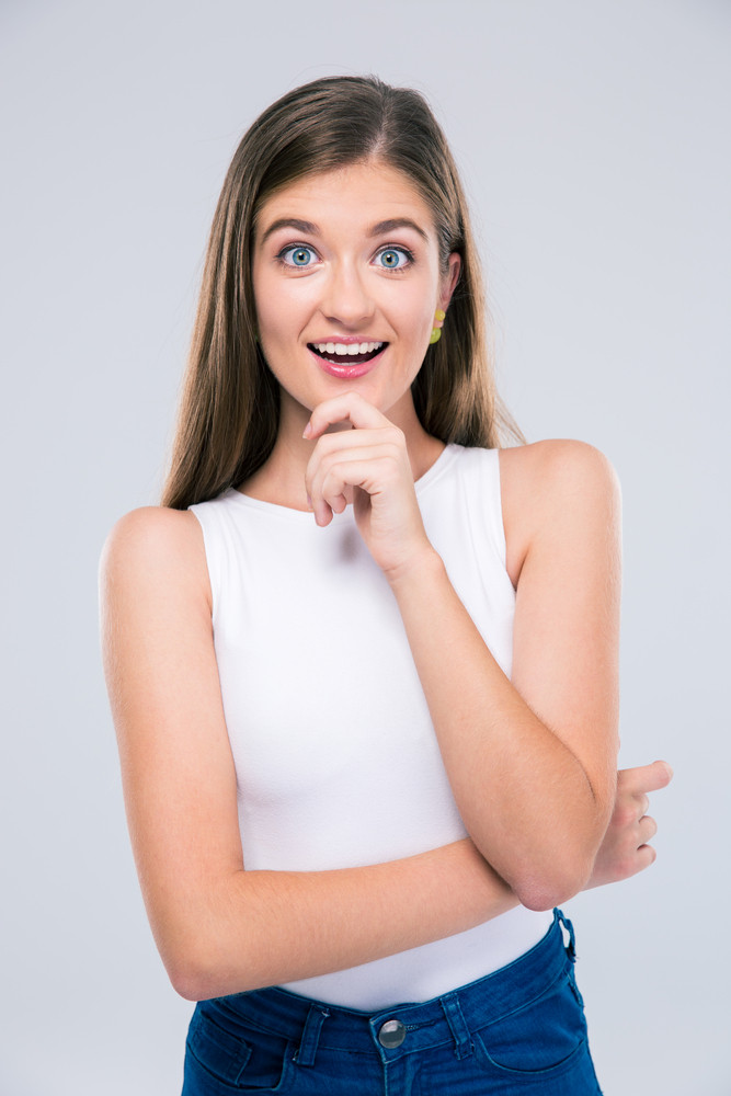 Surprised beautiful woman looking at camera