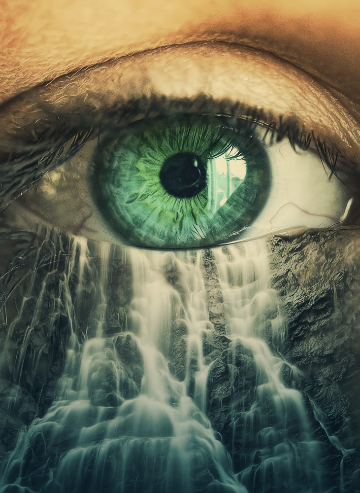 Surreal image of an eye forming a waterfall