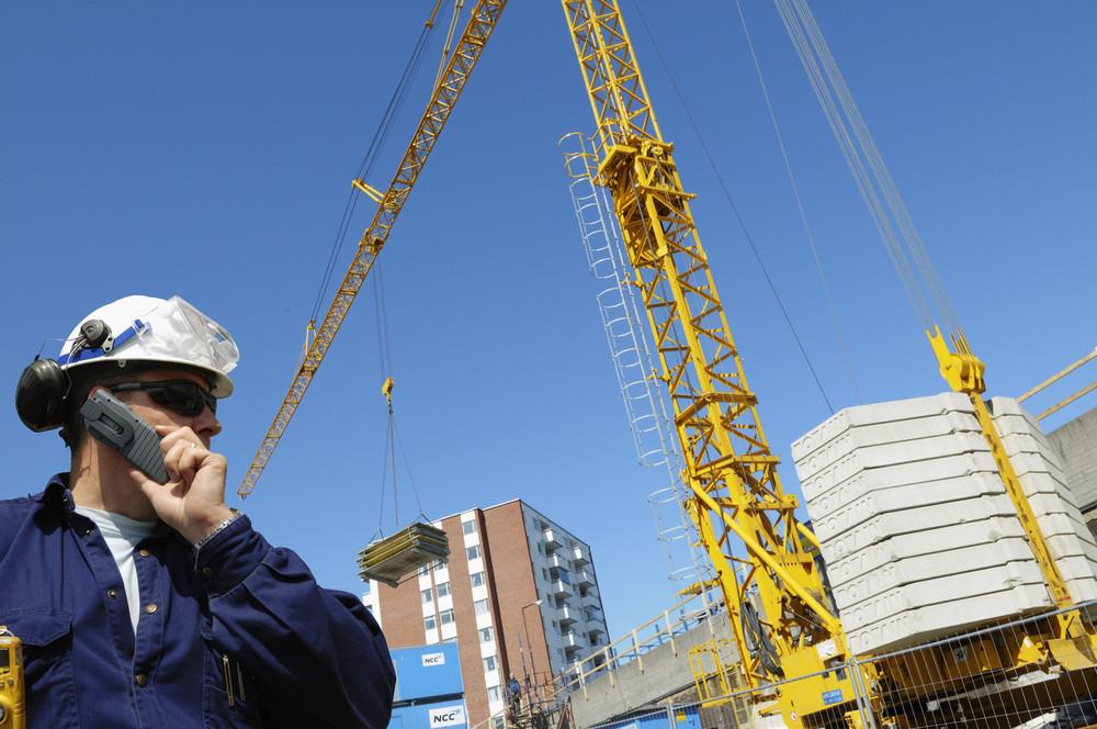 surveyor, engineer checking building site
