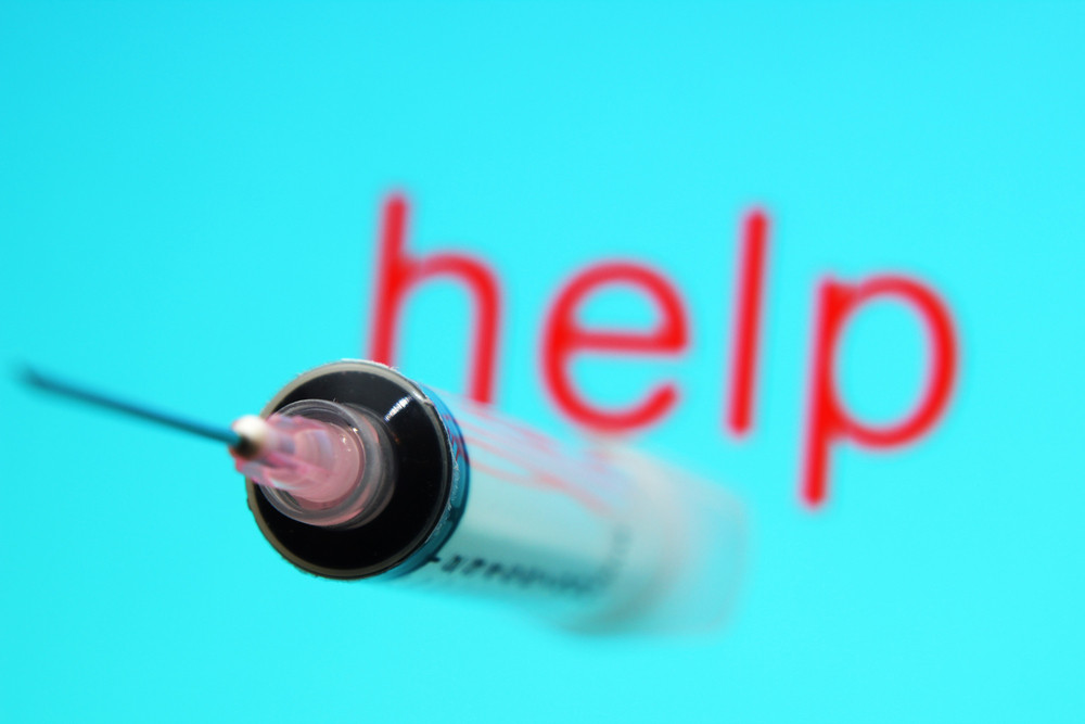 Syringe And Help Text