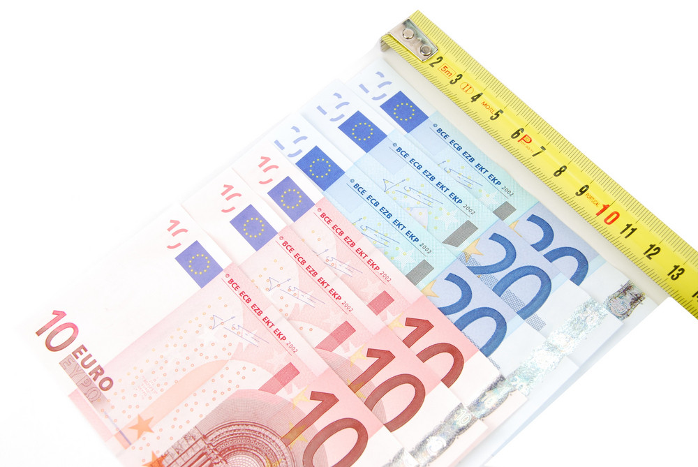 Tape Measure And Euro Bills (concept Of Financial Crisis)