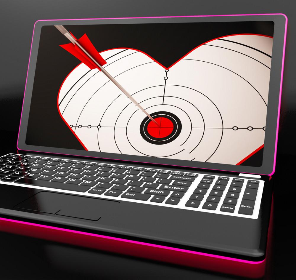 Target Heart On Laptop Shows Flirting