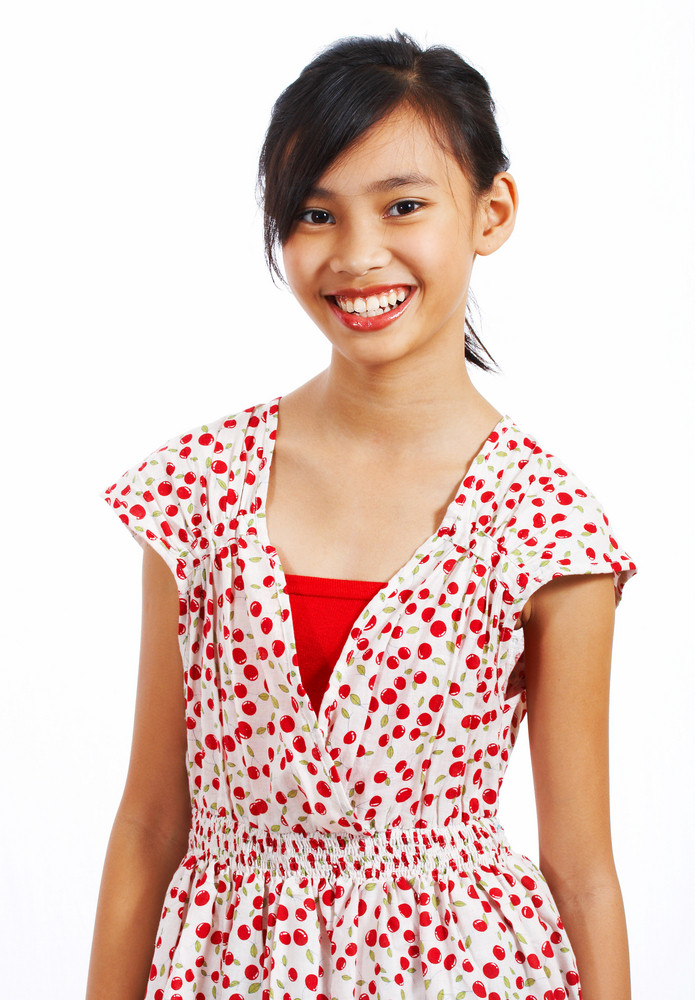 Teenager In A Pretty Dress Smiling
