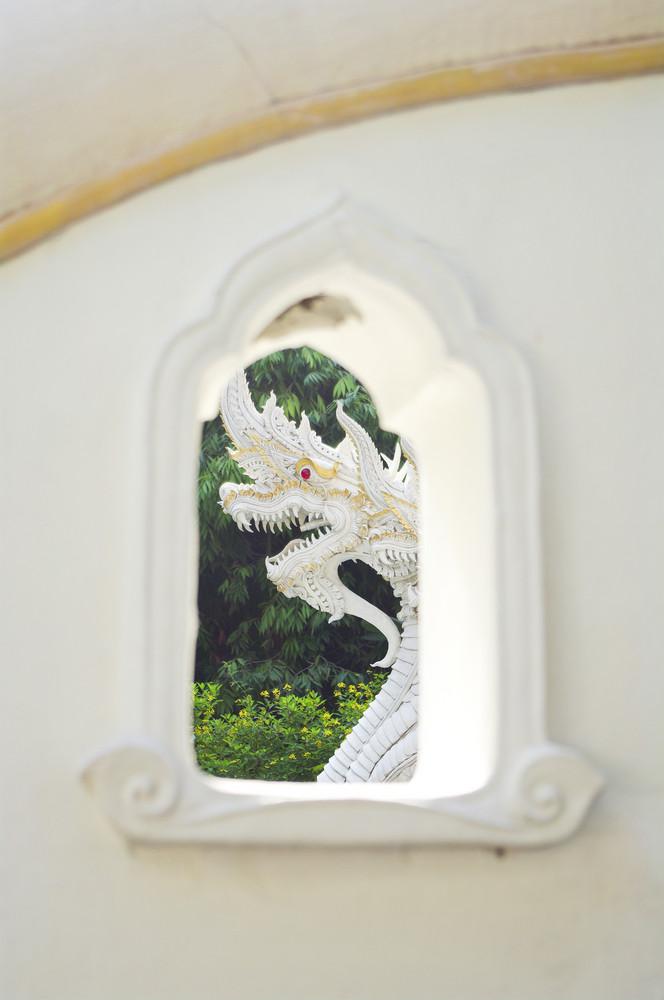 Thai style dragon on white wall