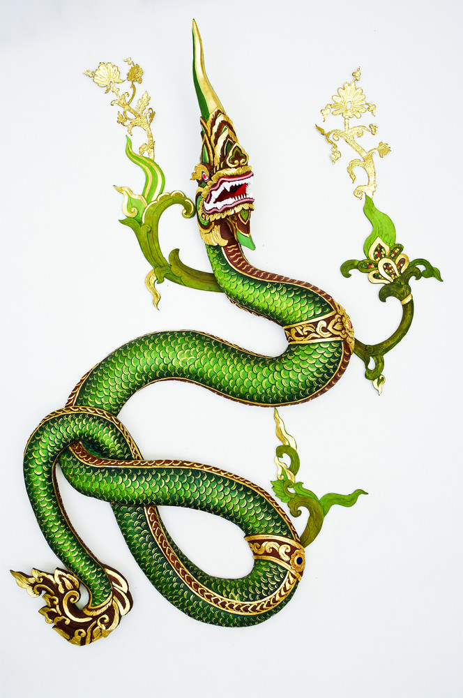 Thai style green dragon on white wall