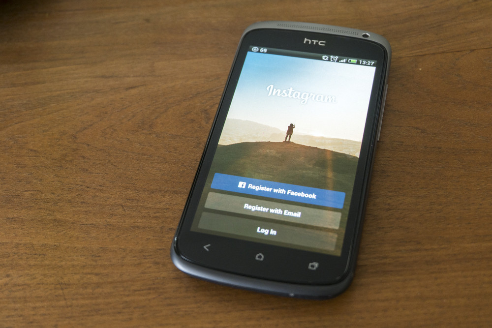 THAILAND - SEPTEMBER 05, 2014: Instagram login screen application on htc smartphone with wood background