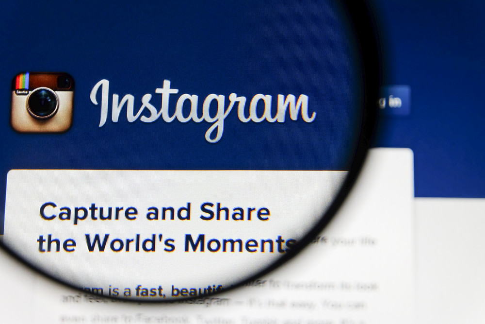 THAILAND - SEPTEMBER 2, 2014: Magnifying glass of Instagram landing page website view on web browser.