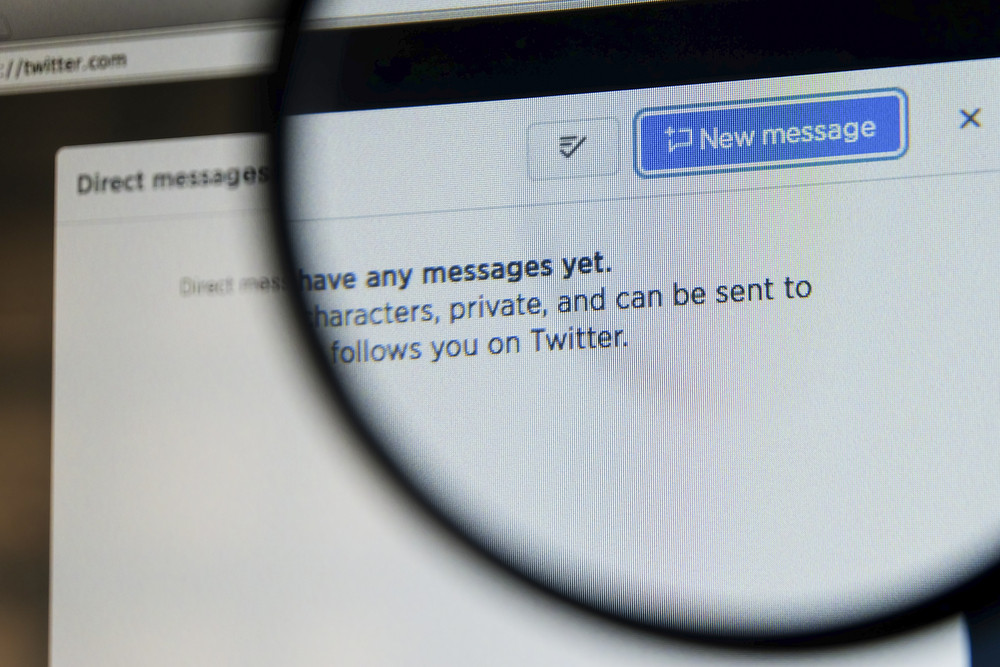 THAILAND - SEPTEMBER 2, 2014: Magnifying glass of twitter page compose new message view on web browser.