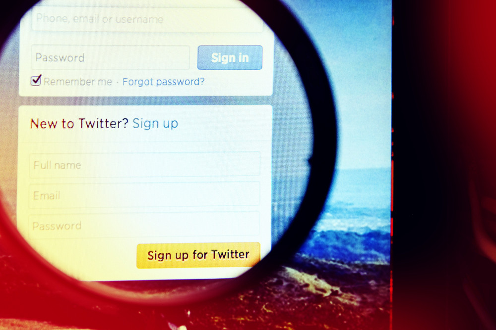 THAILAND - SEPTEMBER 2, 2014: Magnifying glass of twitter page sign up view on web browser.