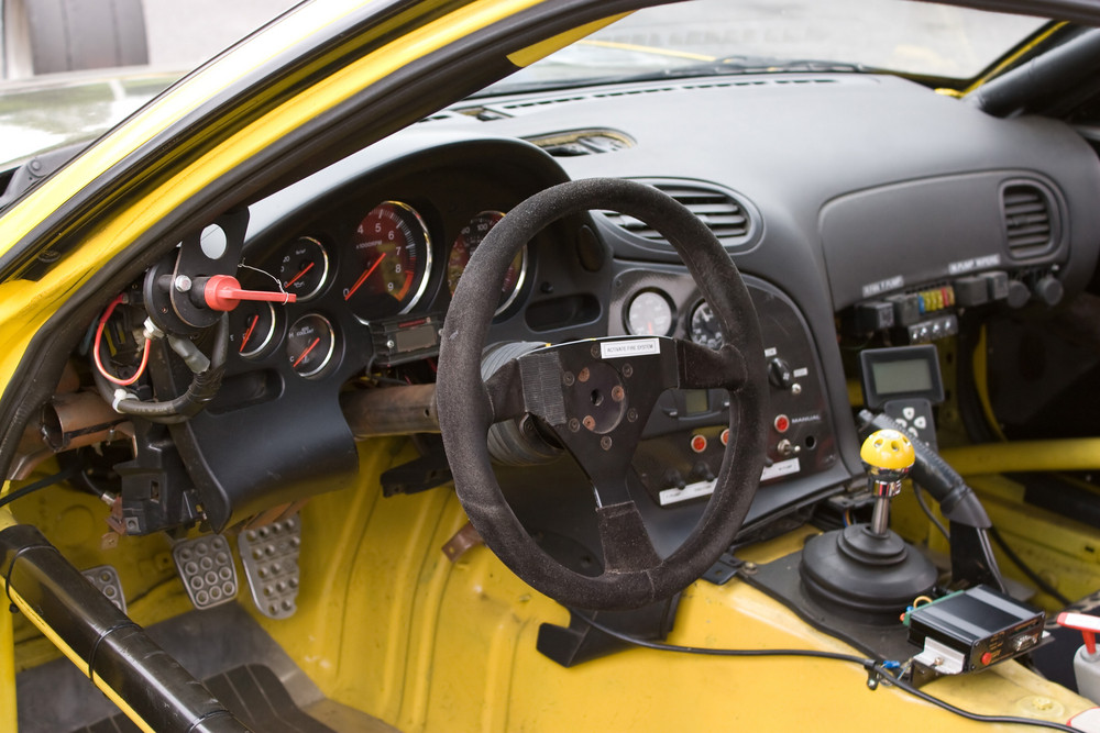 The cockpit of a sports car customized for track racing