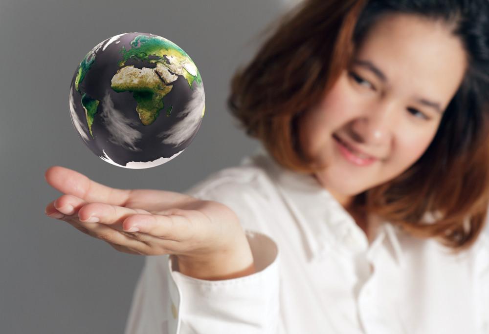 The Earth Globe In Hand