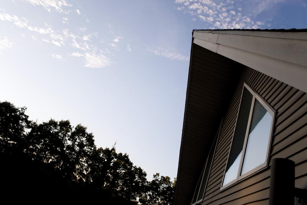 The front facade of a modern contemporary A frame style home.