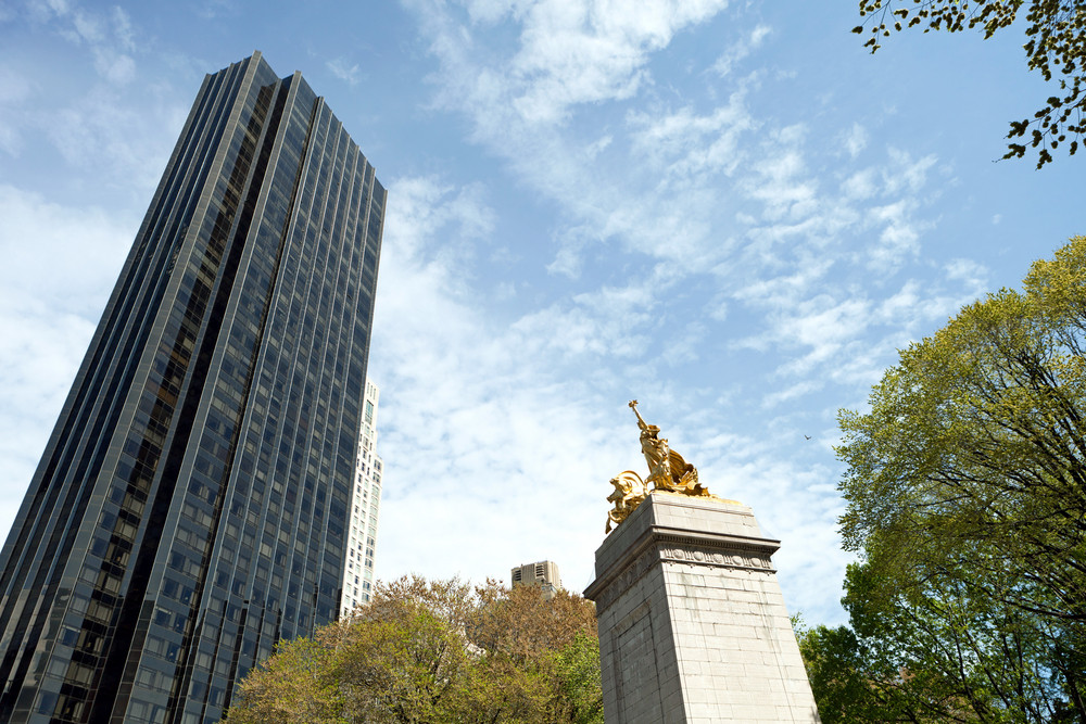 The historic golden Maine monument statue located in Colombus Circle at the south entrance of Central Park in New York City Manhattan.