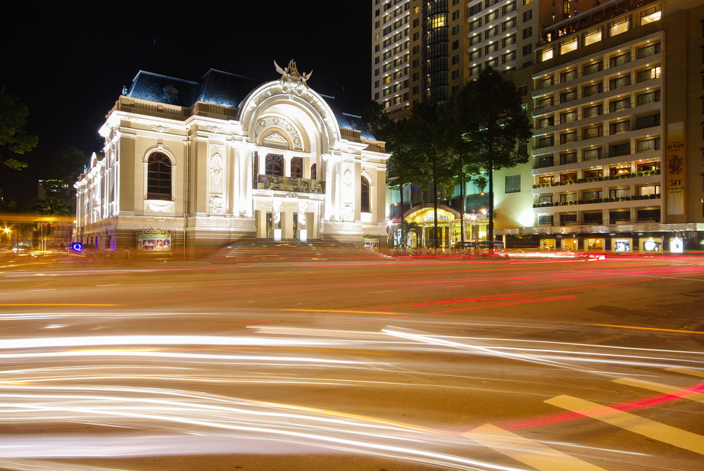 The opera house of Saigon Vietnam with stream of passing traffics