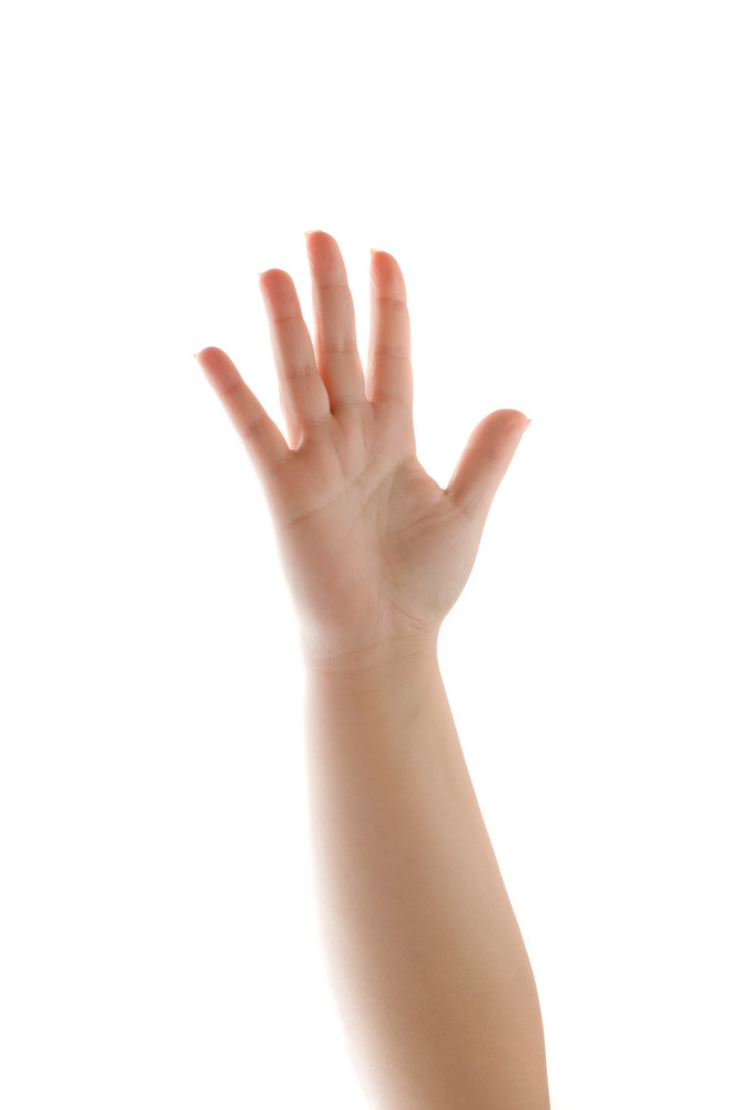 The palm of a human hand and forearm waving with five fingers extended while isolated over a white background.
