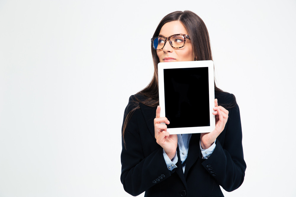 Thoughtful businesswoman showing tablet compute