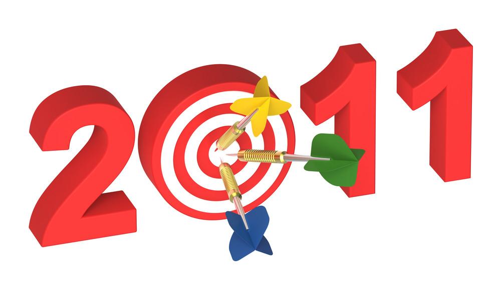 Three Darts Hitting Target - New Year 2011 Isolated On White.