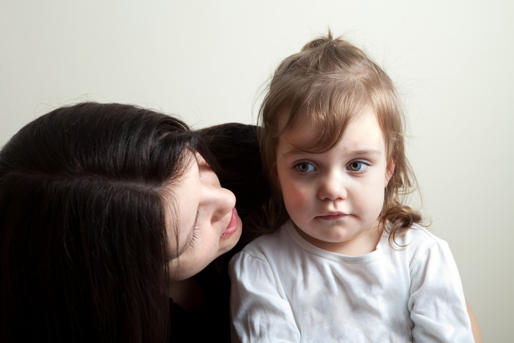 Toddler age girl getting spoken to by her mother. Great parenting concept image.